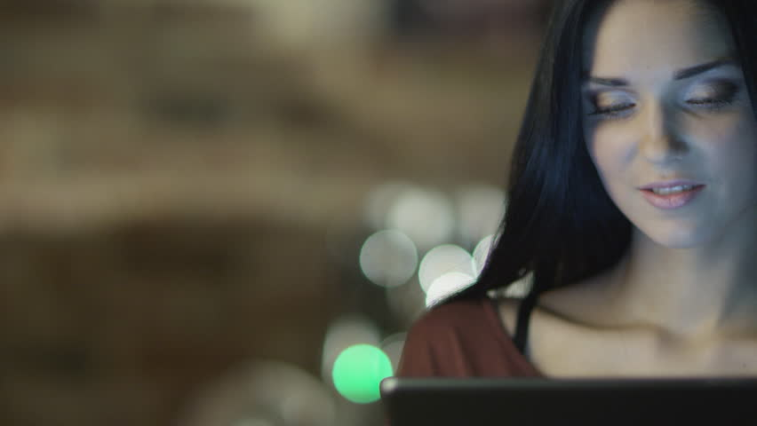 Teen Girl With Beautiful Smile is Using Tablet PC at Evening. Casual Lifestyle. Shot on RED Cinema Camera in 4K. ProRes codec  - Great for editing, color correction and grading.