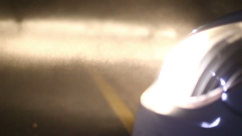 Car headlights in dust. Switching off the headlights.