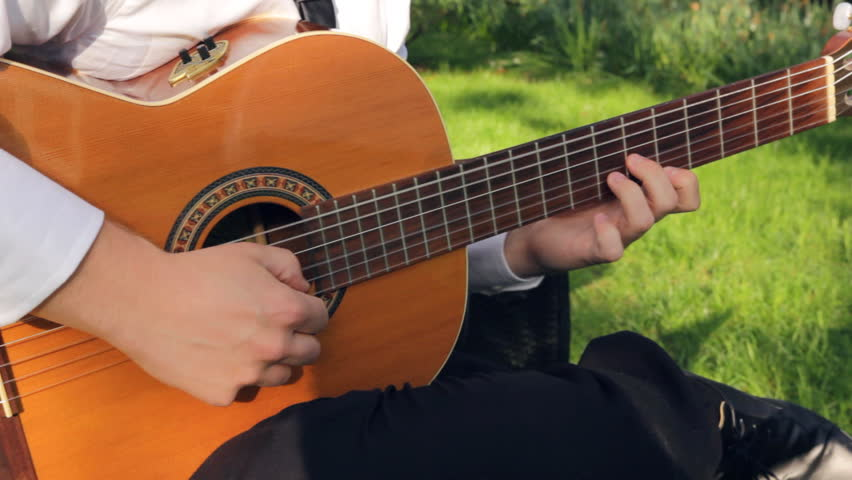 man playing an acoustic guitar outside stock footage video 8124220 shutterstock. Black Bedroom Furniture Sets. Home Design Ideas