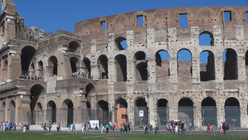 ROME - ITALY, SEPTEMBER 25, 2013, Tourist people visit Great Colosseum forum in sunny day - HD stock video clip