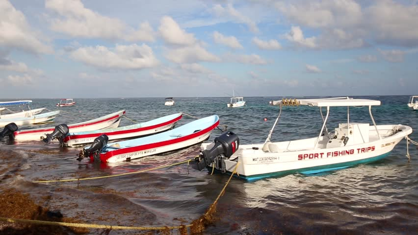 MEXICO, CANCUN - 16 NOVEMBER 2014: Fishing boats near the old wooden pier