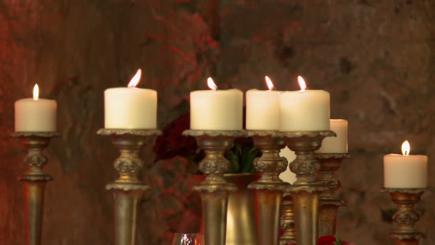 Candles in golden candlesticks as element of decor - HD stock video clip