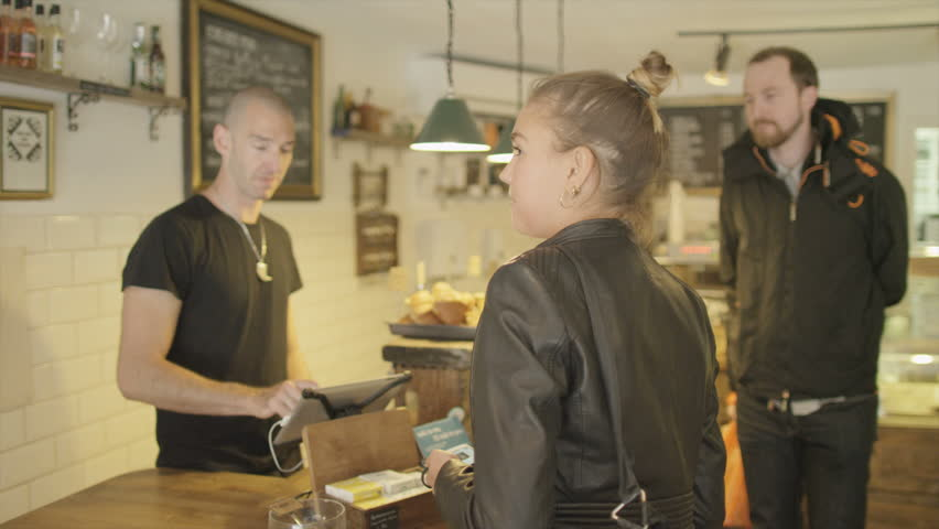 LONDON, UNITED KINGDOM  OCTOBER 01, 2014: Small Coffee House business making food and drink refreshments for passing customers - HD stock footage clip