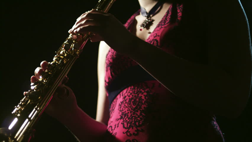 A young trumpeter plays her instrument - HD stock video clip