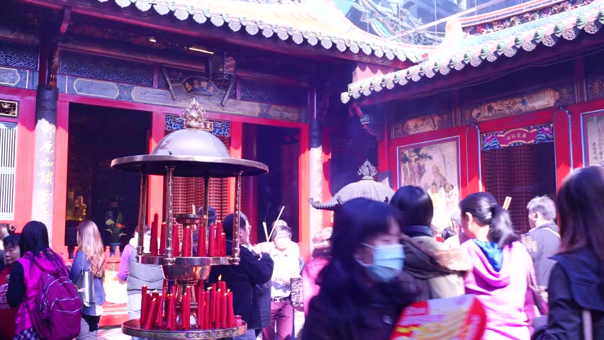 TAIPEI, TAIWAN - OCTOBER 12th : Many people including tourist and believers come to Longshan Temple, Taiwan on October 12th, 2014. It is one of the oldest Traditional Temple in Taipei - HD stock video clip