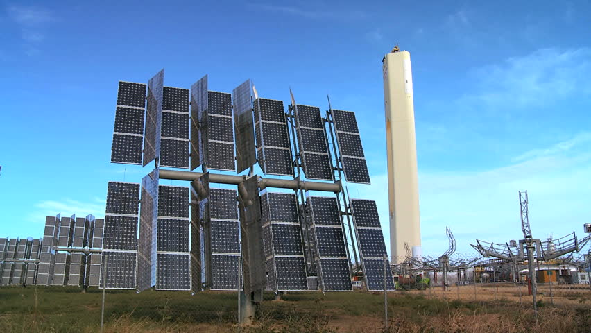 Banks of photovoltaic solar panels producing environmentally clean renewable energy - HD stock footage clip