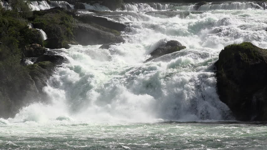 Switzerland Rhine Falls natural waterfall river. Rhine Falls in Switzerland, Rheinfall in German, largest natural river waterfall in Europe. Tourist destination and ecological environmental landscape. - 4K stock video clip