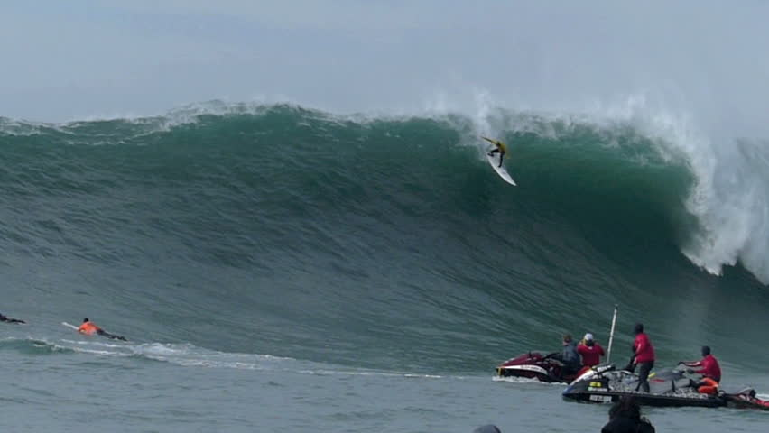 Half Moon Bay, California, USA: Jan. 24, 2014: Professional Surfer, Shawn Dollar surfing on a giant wave during the Mavericks Invitational surf competition, falls and is smashed by the wave.