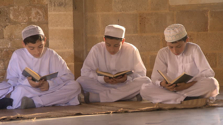 """ADLOUN, LEBANON - SEPTEMBER 25, 2012: Muslims reads Quran, Muslims holy book, inside """"al-nabi Sari"""" mosque, one of the most famous mosques in south of Lebanon, dolly shot."""