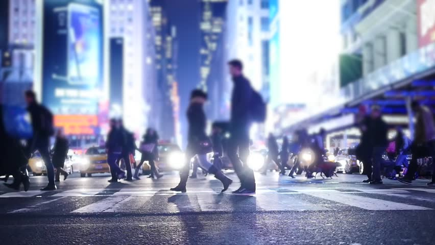 slow motion of pedestrians walking in the city at night. nyc street background