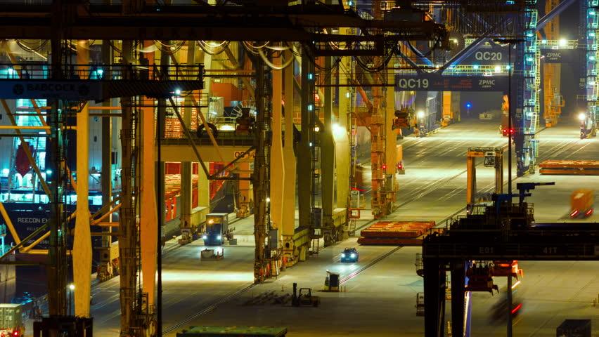 Editorial:December 14 2014 logistics port, Perama harbor, Athens, Greece. 4K cargo container, hoisting cranes, at logistics port night time lapse. Time lapse sequence of machinery handling cargo containers.