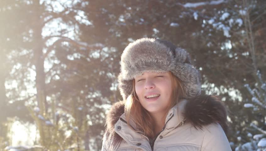 Sunny Winter Joyful Girl running in winter park. Snow. Happiness.  - HD stock footage clip