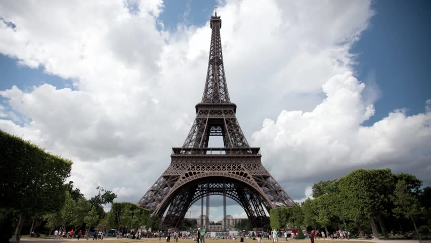 PARIS - JULY 29: Time lapse of tourists near Eiffel Tower in Paris, Paris has a population of 2,249,975 inhabitants, on july 29, 2013 in Paris, France | Shutterstock HD Video #8311726