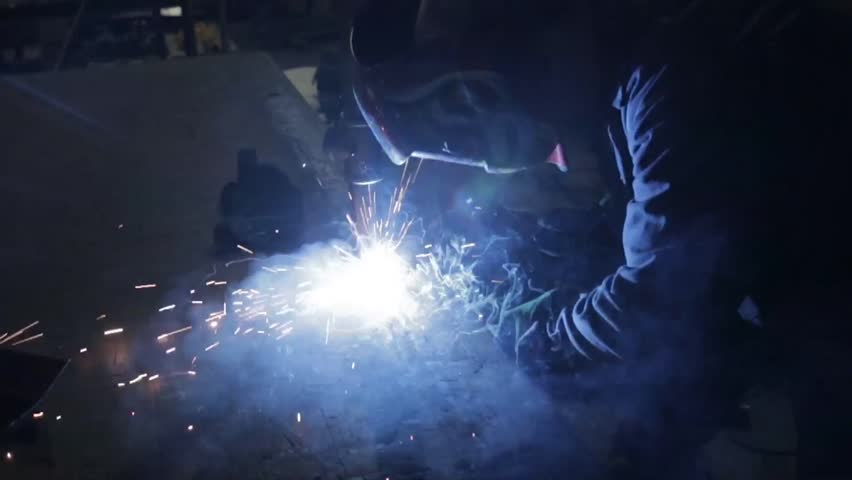 Man using welding in a metal fabricating workshop - HD stock video clip