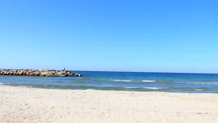 Beautiful sand beach against the sea and sky   Shutterstock HD Video #8385787