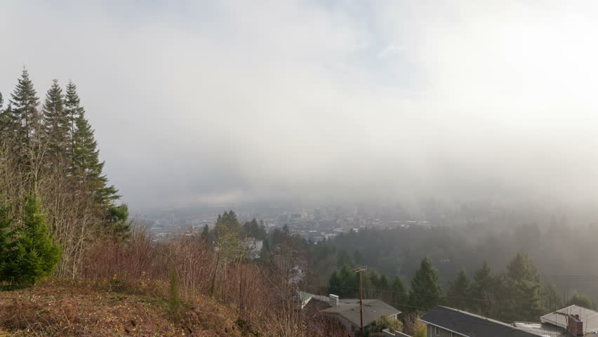 Time Lapse Movie of Moving Clouds and Low Fog over Portland Oregon Downtown Cityscape One Early Morning 1920x1080 - HD stock footage clip