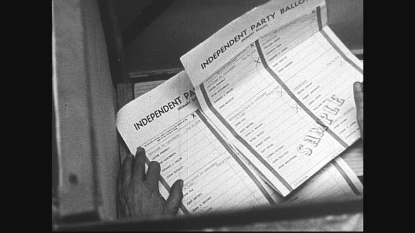 United states 1950s high angle shot of man marking on ballot close