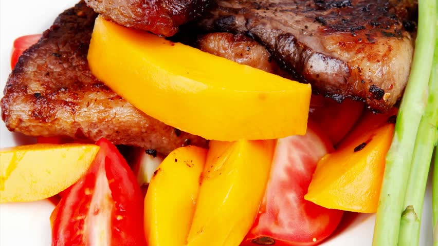 meat food : rare medium roast beef fillet with mango tomatoes and asparagus served dish over wooden table 1920x1080 intro motion slow hidef hd - HD stock footage clip