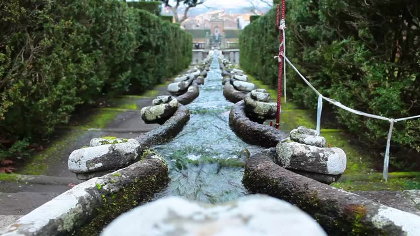 Fountain of the Chain in the gardens of Villa Lante, Bagnaia, Italy. Water flowing from the fountain of the dolphins spurts into the jaws of a crayfish, the symbol of Cardinal Gambara.