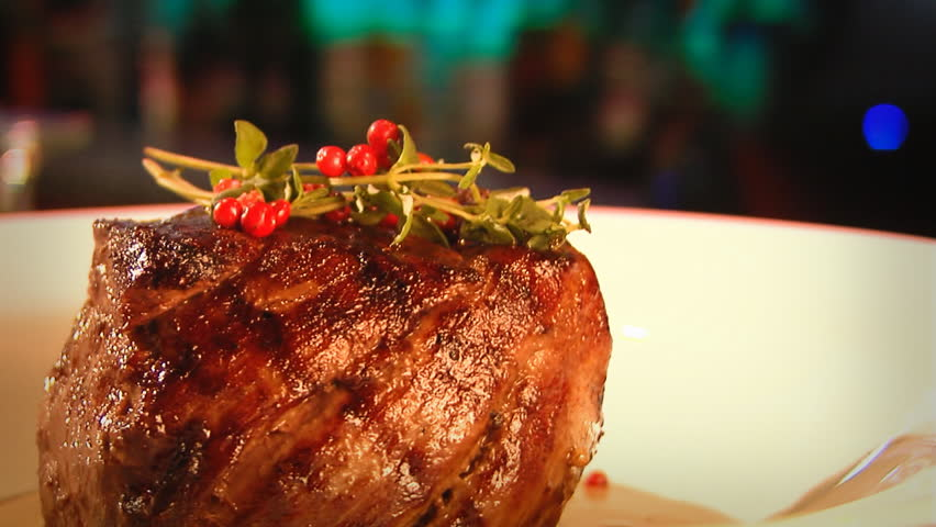 meat rotating on a dinner plate - HD stock video clip