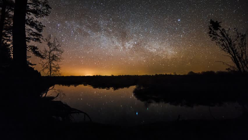 Milky Way rising over the foggy lake time lapse