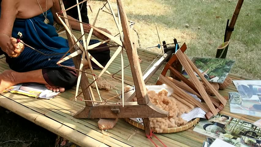 spinning cotton with the wheel - HD stock video clip