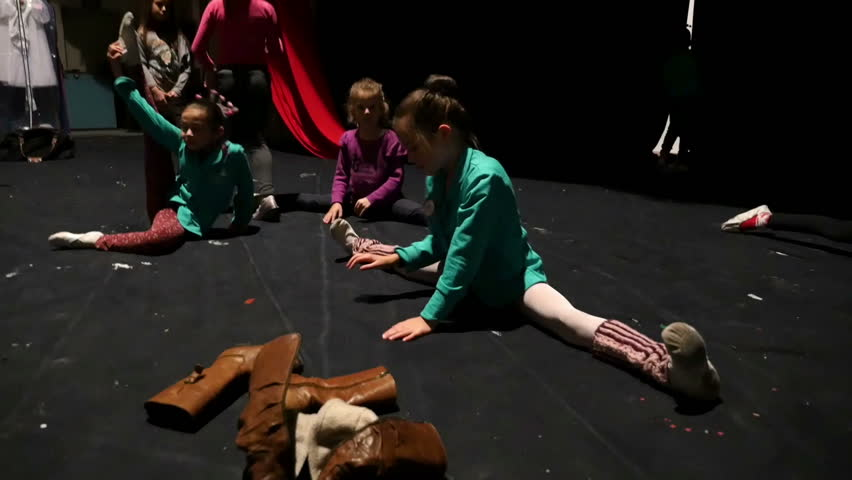 VELIKO TARNOVO, BULGARIA - DECEMBER 18, 2014: Small ballerinas warming up behind the scenes. - HD stock footage clip