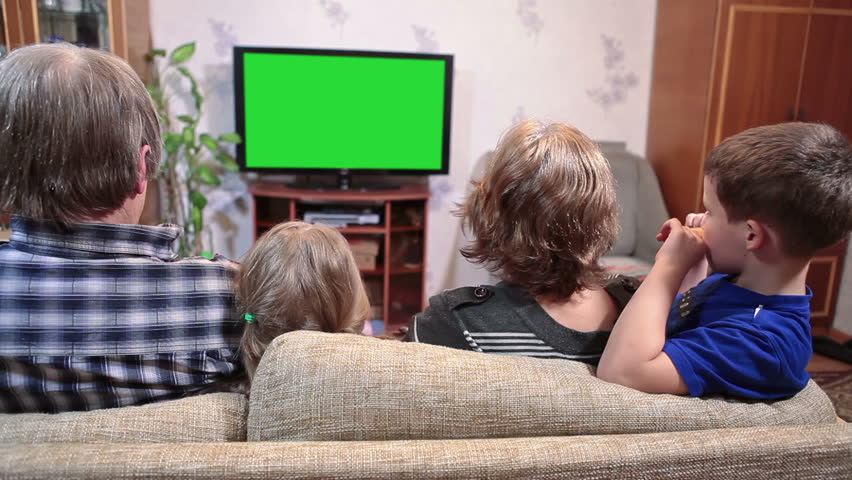 Four people family watching tv with green screen, siting sofa together, parents with two children | Shutterstock HD Video #8628418