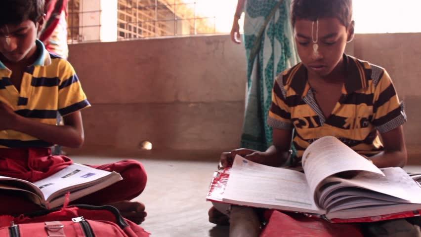 Children reading in village school India panning shot. Rotating pan. Filmed at the Golden Avatar school in Navadvipa, Bengal, India.