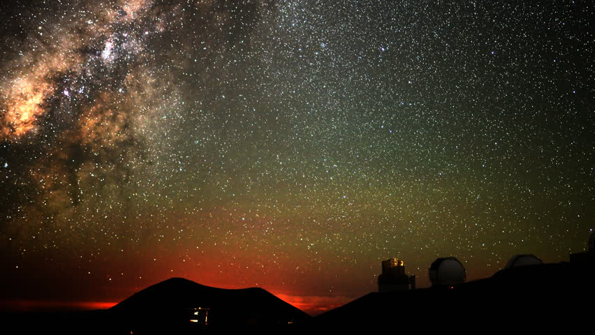 4K Astrophotography time lapse with pan right motion of milky way galaxy over Mauna Kea Observatories in Hawaii at dawn