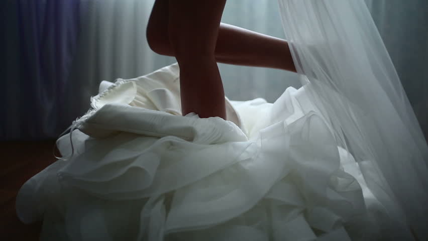 Buttoning the wedding dress - HD stock video clip