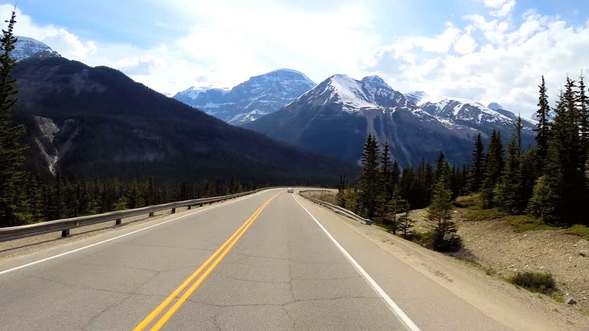 POV driving scenic route beauty Icefields Parkway Canada geography landscape glacial mountains forests outdoor activity | Shutterstock HD Video #8729650
