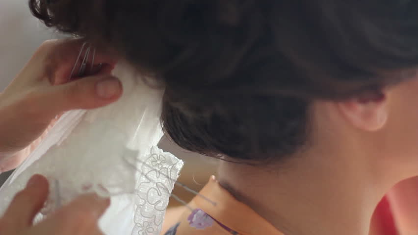 hairdresser dress veil to bride - HD stock footage clip