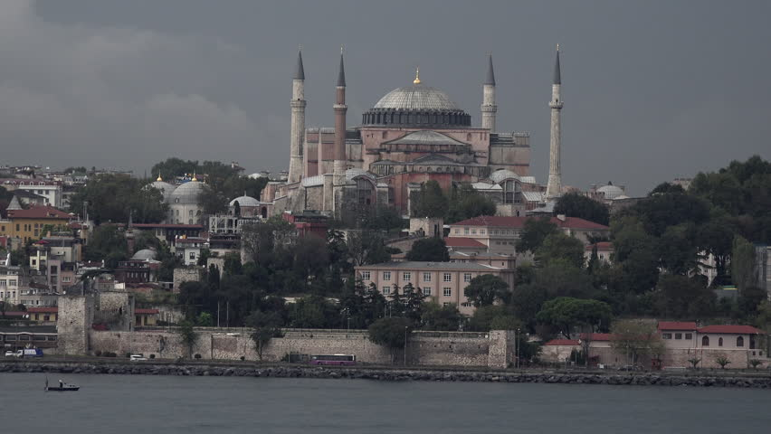 ISTANBUL, TURKEY - SEPT 2014: Istanbul Hagia Sophia Mosque old city traffic from boat. Near Sultan Ahmed Mosque or Blue Mosque. Traditional Islamic architecture. Religious center for Islam Muslims. - 4K stock footage clip