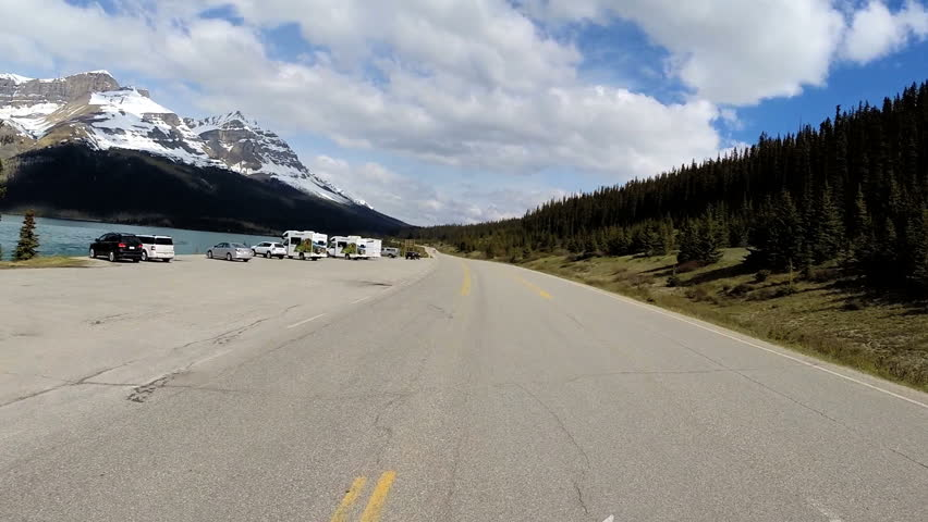 Icefields Parkway, Canada - September 2014: POV driving Highway 93 glacial valley mountains forest landscape visitor travel destination - HD stock video clip