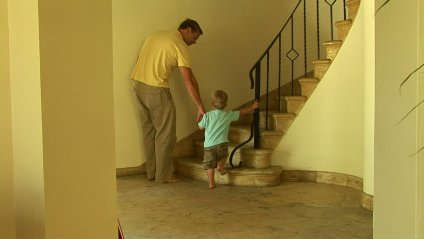 Father and toddler son walking up stairs - HD stock video clip