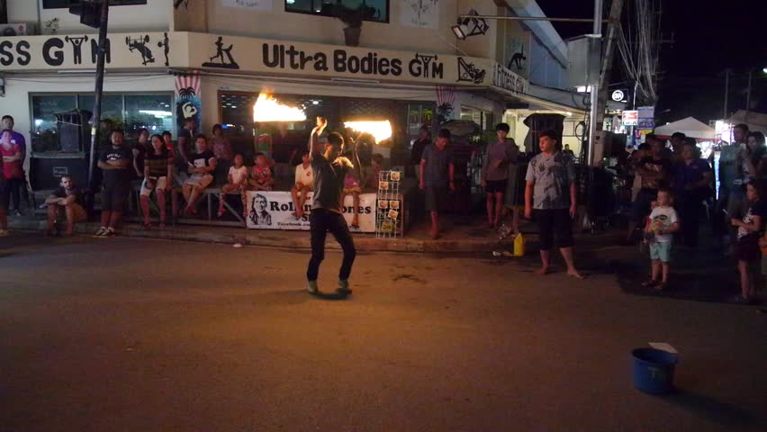 THAILAND, KOH SAMUI, DECEMBER 2014 - Fire Juggler Performing on the Street in Thailand. Tropical Island of Koh Samui. HD, 1920x1080
