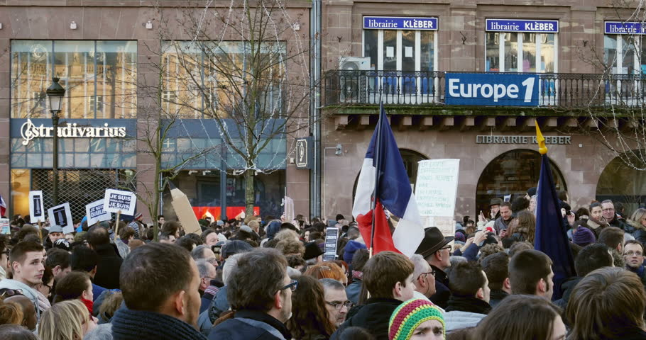 STRASBOURG, FRANCE - 11 JAN, 2015: French citizens hold placards reading 'Je suis Charlie' during a unity rally (Marche Republicaine) where 50000 took part in tribute  - 4K stock footage clip
