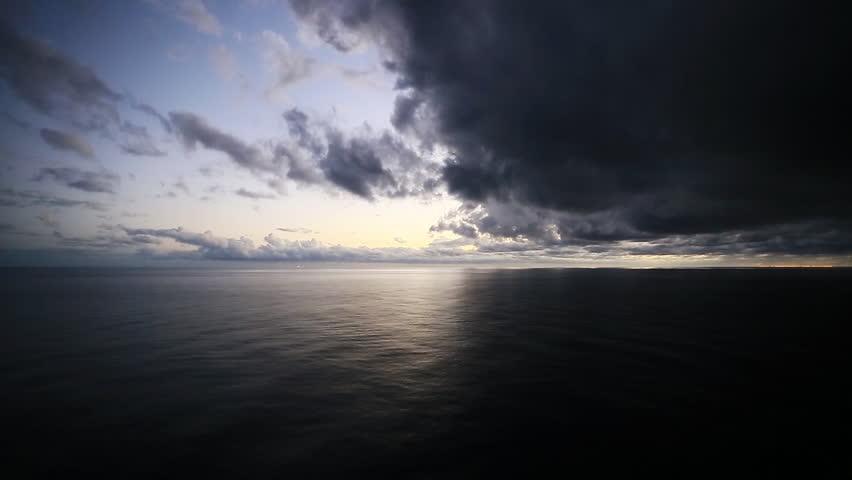 Dark and light clouds over tropical Caribbean ocean. Good vs evil. 1080p HD.