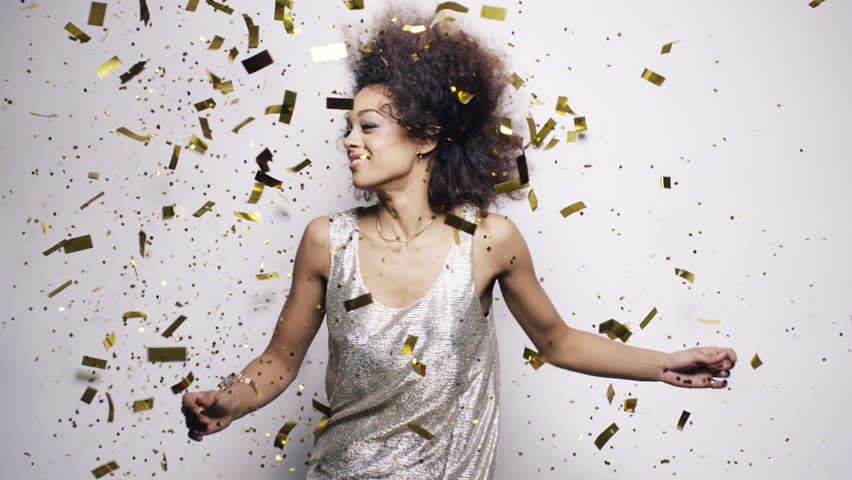 Beautiful hispanic woman dancing throwing gold confetti slow motion - Red Epic Dragon #8784208