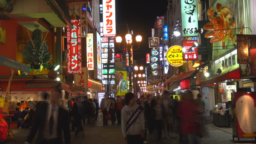 OSAKA, JAPAN - APRIL 15, 2012, Timelapse of tourist people visit Dotonbori shopping district with neon sigh by night - HD stock video clip