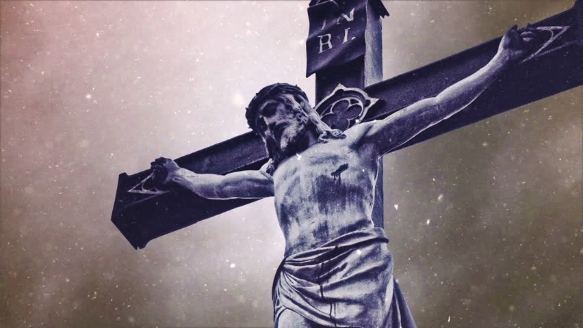 Crucifixion cross with Jesus Christ statue over stormy clouds and Snow falling time lapse as Religious Christian Concept. - HD stock video clip