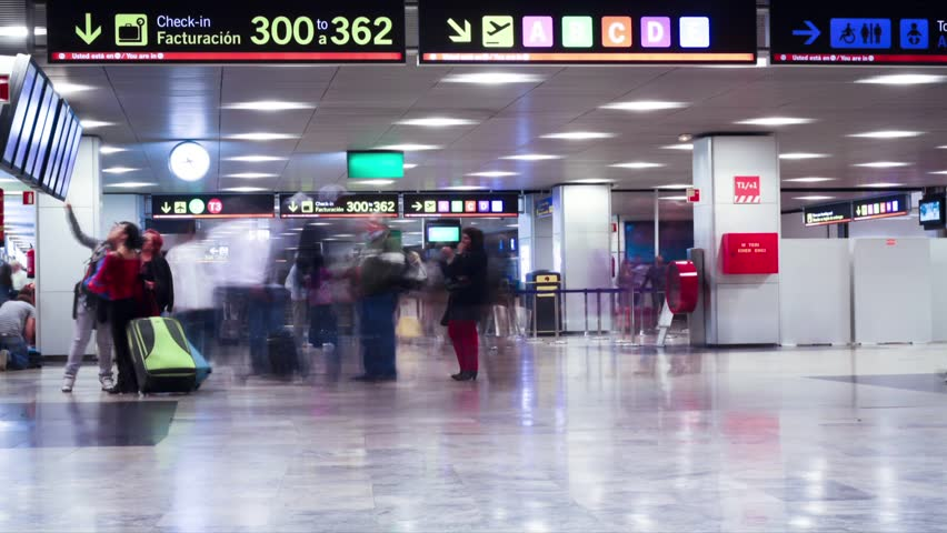 People hurrying in the Barajas T1 airport. Time Lapse