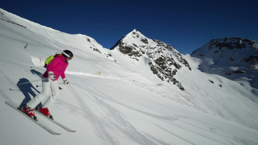 two skiers walking on skis off piste