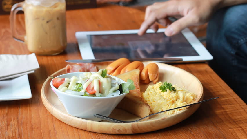eating breakfast before work with tablet - HD stock footage clip