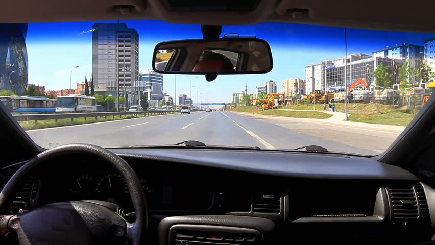 In-city traffic on E5 Road. Highway from car interior at Maltepe Region in Istanbul. Driving with a mounted video camera in car