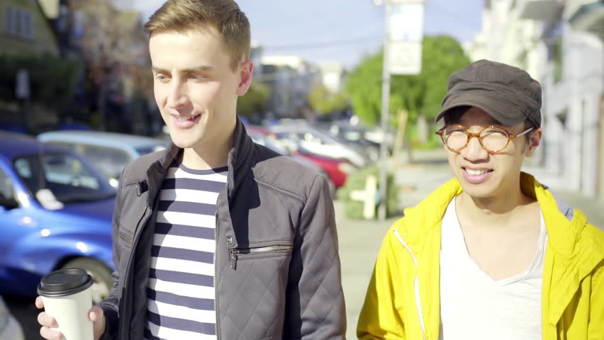 Gay Couple Wait For Cars, Then Walk Across Street, With Their Morning Coffee (Slow Motion)