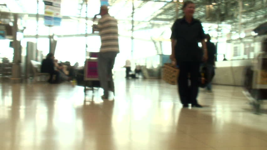 People walking in an airport - HD stock footage clip
