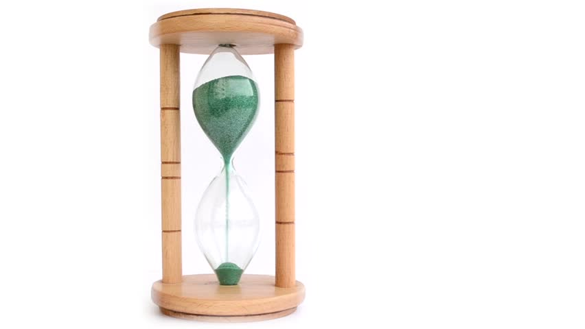 """""""A wood made hourglass with complete green sand drainage, on a white background. Suitable for time/urgency illustration."""