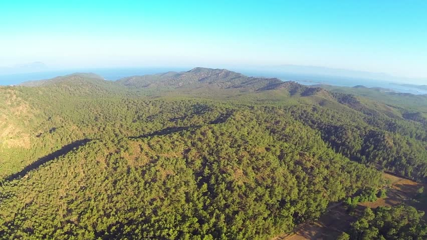 Beautiful dense forested hill in Marmaris in Turkey Country. Helicopter shoot of Mediterranean nature in the continental part, near Marmaris in Turkey. Aerial Panoramic View